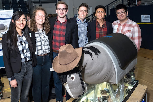 Rice University students presented their version of a mechanical horse for hippotherapy at the George R. Brown Engineering Design Showcase, where they won an Excellence in Capstone Engineering Design Award. From left: Jijie Zhou, Kelsi Wicker, James Phillips, Matthew O'Gorman, Wesley Yee and Sebastian Jia.