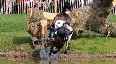 Ireland's James O'Haire and China Doll come to grief at one of the water obstacles.