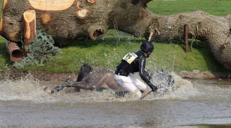 Ireland'sJames O'Haire and China Doll come to grief at one of the water obstacles.© Mike Bain