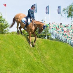 Hickstead Al Shira'aa Derby winner William Funnell and Billy Buckingham head down the derby bank at  Hickstead. © Nigel Goddard