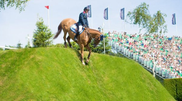 Hickstead Al Shira'aa Derby winner William Funnell and Billy Buckingham head down the derby bank at Hickstead.