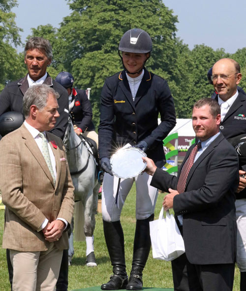 Bramham Horse Trials President Nick Lane-Fox and Equi-Trek CEO Tom Janion present the CCI3* trophy to Julia Krajewski, with second placed Andrew Nicholson and Bill Levett (third) on the podium.