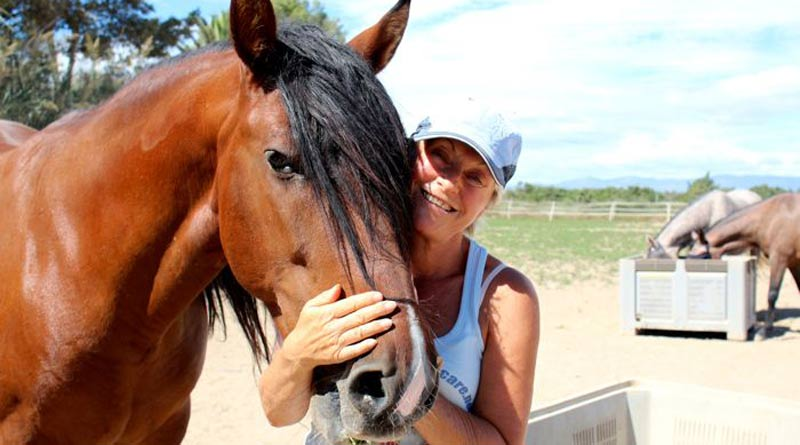 Sue Weeding with Luciero, the horse who started their horse rescue operation.