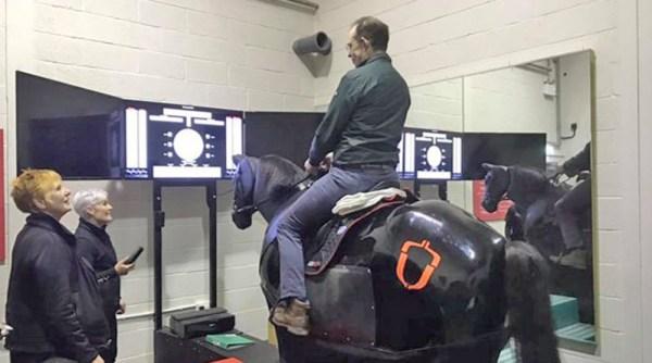 Jonty Evans uses Hartpury's horse riding simulator aspart of his rehabilitation from a serious head injury.