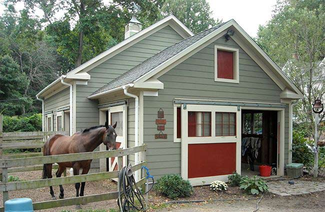 A pretty barn and an equine companion or two live cozily in a residential back yard zoned for horse keeping. Image courtesy Shedswindowsandmore.com