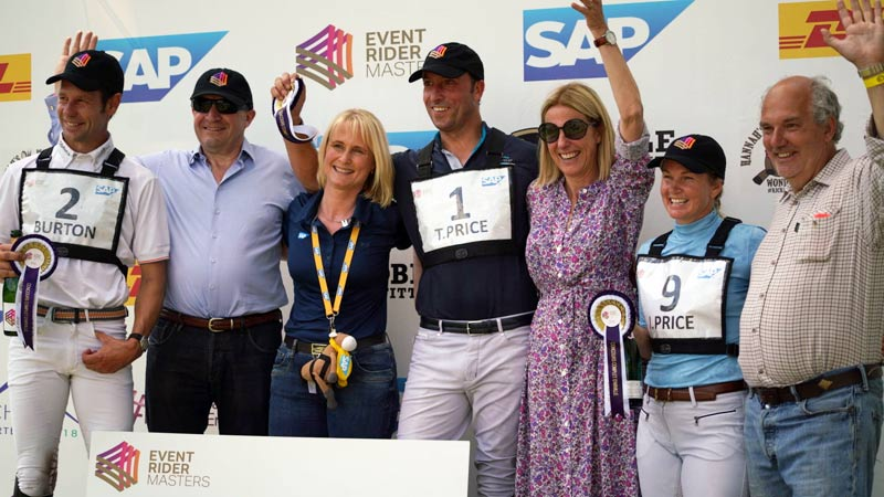 Tim and Jonelle Price and Chris Burton celebrate with supporters after the CCI4*-S Arville Event Rider Masters in Belgium.