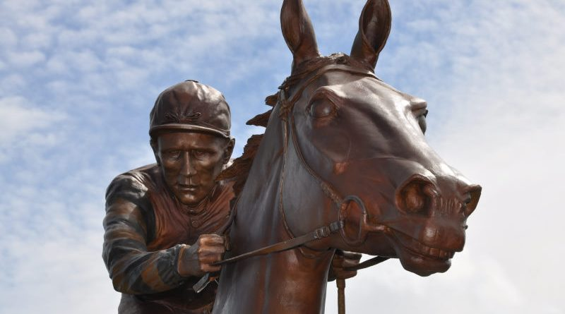 The life-size bronze of Phar Lap shows the champion at full stride, with regular jockey Jim Pike in the saddle.