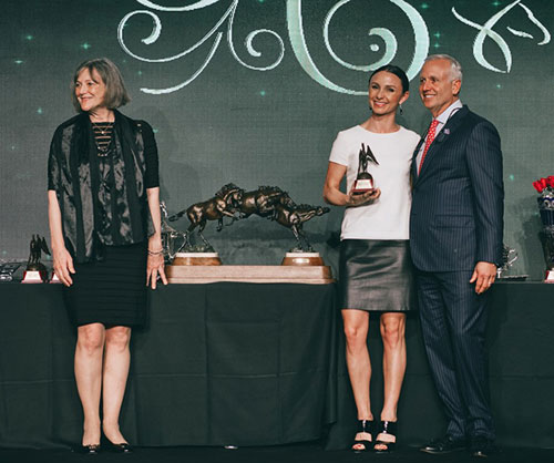 Georgina Bloomberg receives the Equus Foundation Humanitarian Award from Equus Foundation President Lynn Coakley and US Equestrian Federation President Murray Kessler.