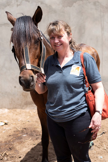 Petra Ingram with a horse in the village of Ndeukou Diagne in Senegal.