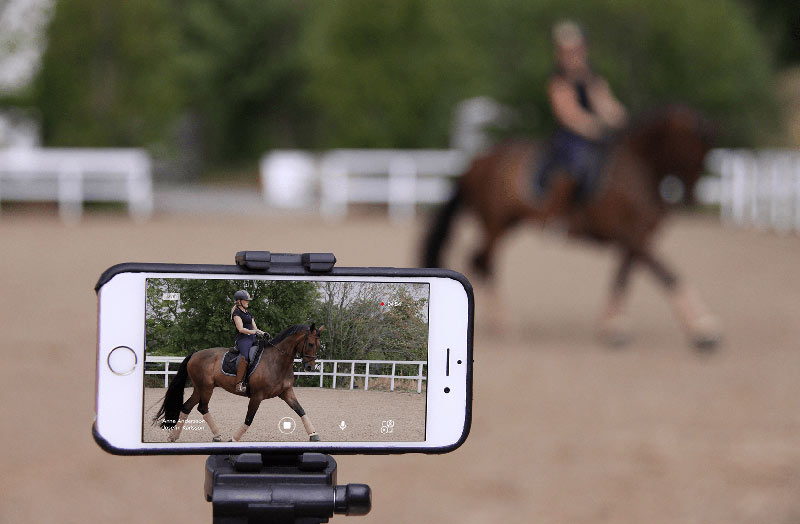 Ridesum in use. Riders are able to train live digitally on their own or with the assistance of a person filming.