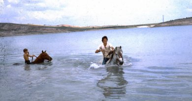 Jim and Scott swimming the horses in a pantano to cool off.