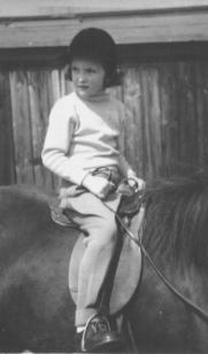 Born in Zurich, Switzerland in 1947, Basha Cornwall-Legh began riding horses at the age of five. This photograph shows Basha riding Mustard, her first pony.