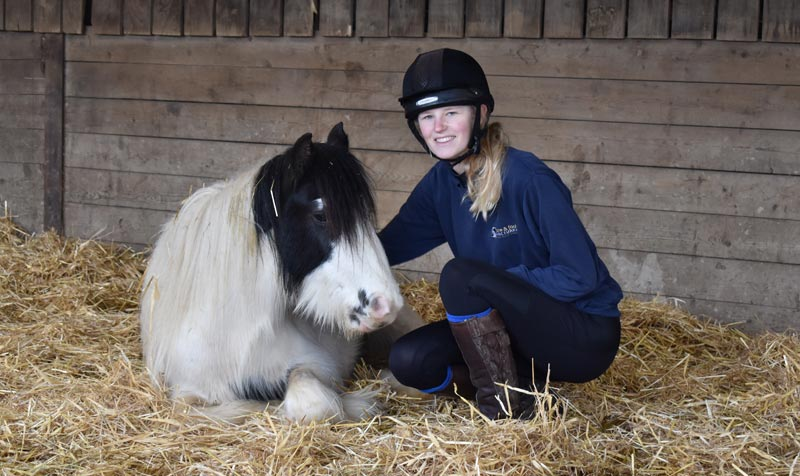 Becky Eustace with Baby Shark, one of the youngsters signed over to The Mare and Foal Sanctuary following a rescue of 137 horses in November 2019.