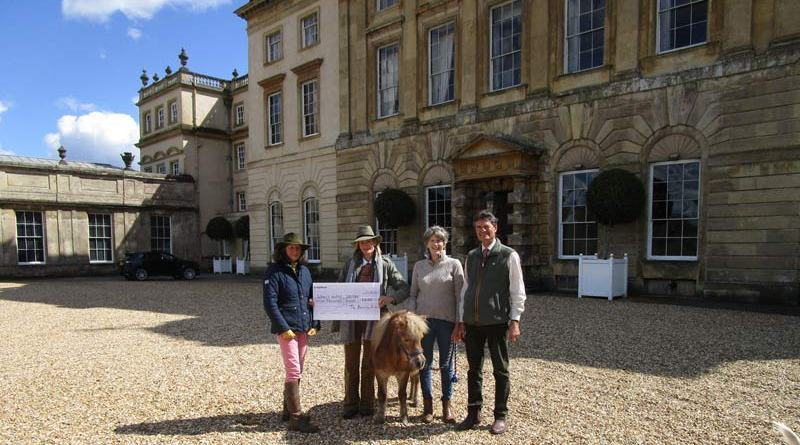 Dylan receives the cheque from Badminton Ride on behalf of World Horse Welfare.