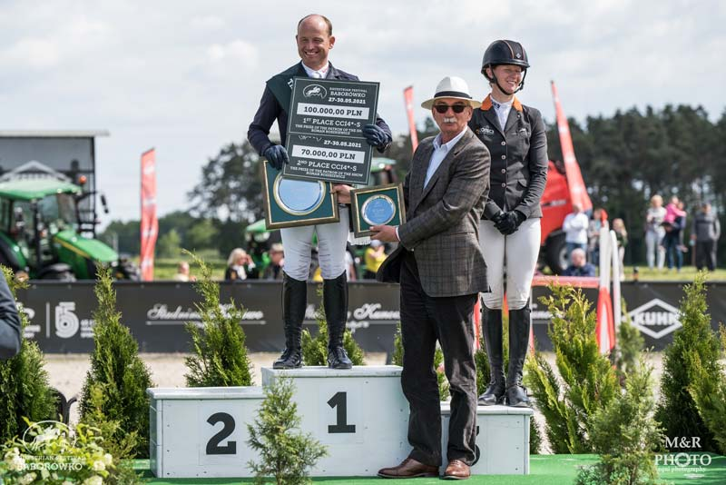 Michael Jung accepts his prizes for first and second in the CCI4*-S at Baborówko in Poland. Sandra Auffarth was third