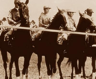 Elizabeth Taylor, as Velvet Brown, on the second horse from left at the start of the race in National Velvet.
