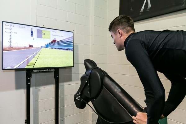 A student on a hi-tech riding simulator at Hartpury University.