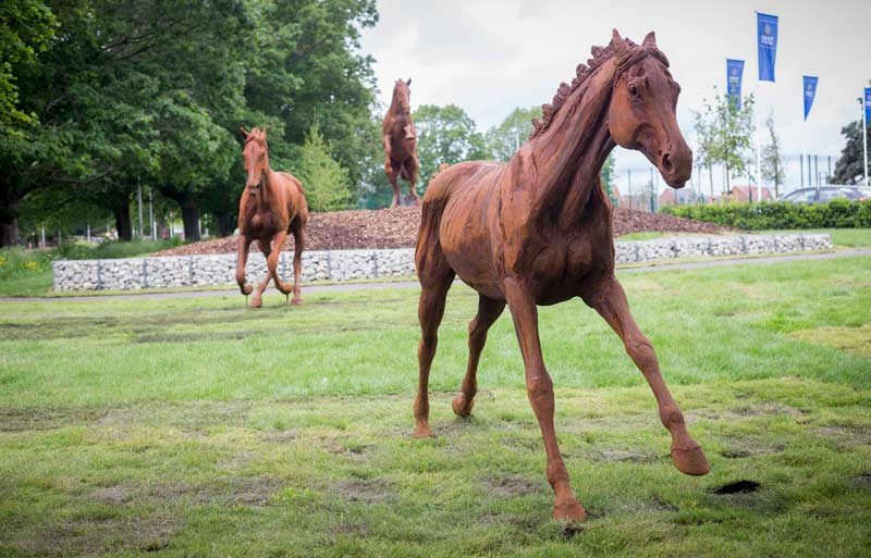 Three iron-resin horse statues have been created by Amy Goodman for the Arborfield Green development near Wokingham in Britain.