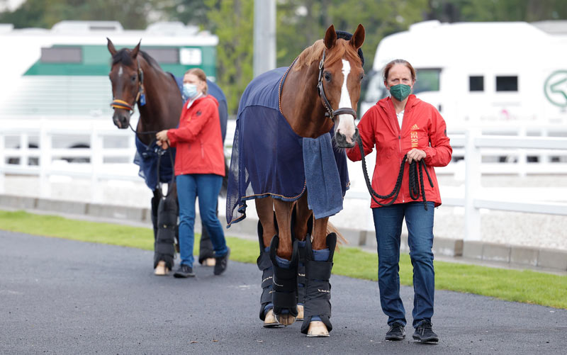Dressage groom Stefanie Wiegan greets Bella Rose at the equestrian venue following the arrival of the first group of dressage horses into Haneda Airport in Tokyo, Japan, this week.