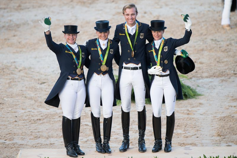 Celebrating Germany's 13th Olympic Dressage team gold at the Rio 2016 Olympic Games: (L to R) Isabell Werth, Dorothee Schneider, Sönke Rothenberger and Kristina Bröring-Sprehe.