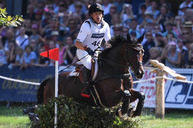 Germany's Michael Jung, pictured in Luhmuhlen with his 2019 European Championship horse fischerChipmunk FRH, is aiming to make history with a hat trick gold in Tokyo.