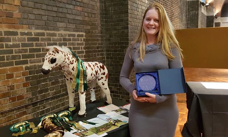 """Liverpool University behaviour change scientist Dr Tamzin Furtado with some of the """"ideal weight"""" awards."""