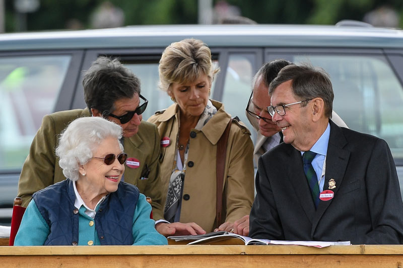 Queen Elizabeth II watches the Retraining of Racehorses class on Saturday with Colin Brooks Esq, chairman of the Royal Windsor Horse Show. Her horse, First Receiver, won the class.
