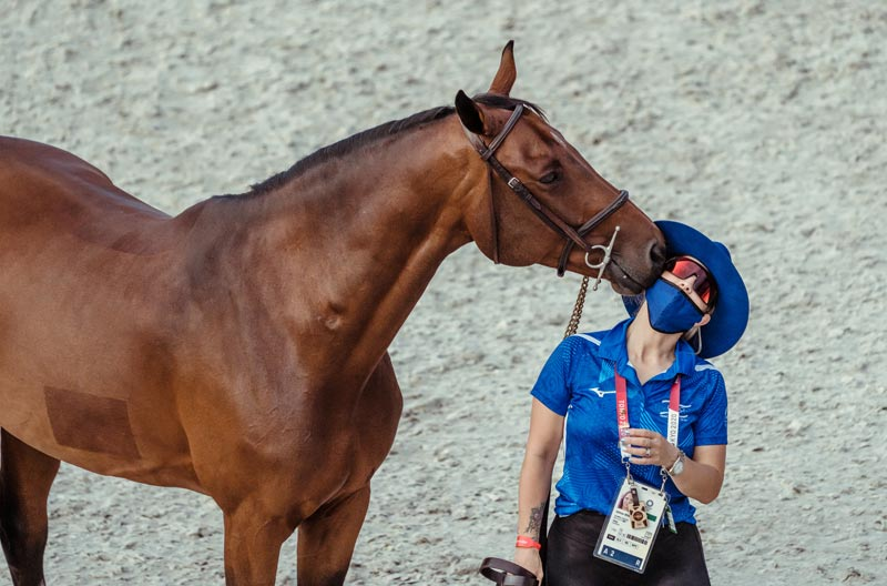 Ashlee Bond (Israel) shares a moment with Donatello 141 at the second Jumping Horse Inspection at Baji Koen on Thursday night, ahead of the Tokyo 2020 team showjumping contest.