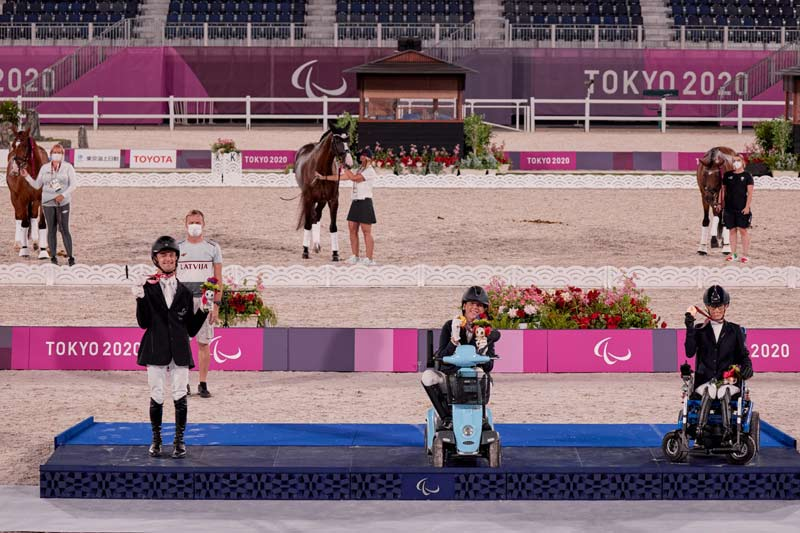 Equestrian Freestyle Grade 1 medalists, from left Rihards Snikus (LAT) silver; Roxanne Trunnell (USA) gold; and Sara Morganti (ITA) bronze.