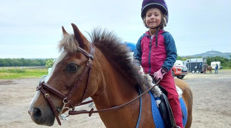 Livvy Johnson, 6, with Blue Cross pony Perry.