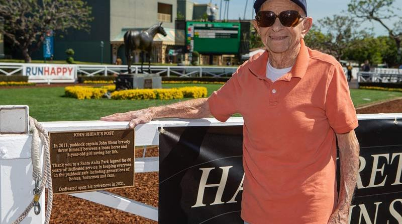 John Shear with the commemorative plaque unveiled on October 1 at Santa Anita.