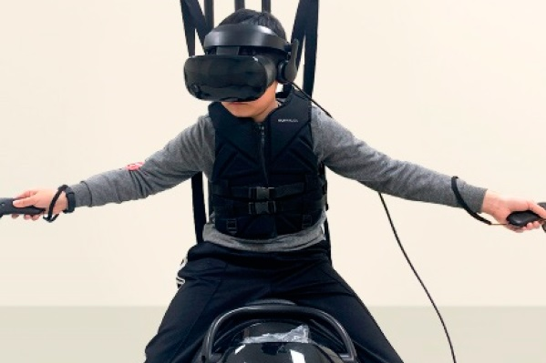 Adding a virtual reality horseback experience to a riding simulator improved the appeal of the therapy for children with cerebral palsy, researchers report.