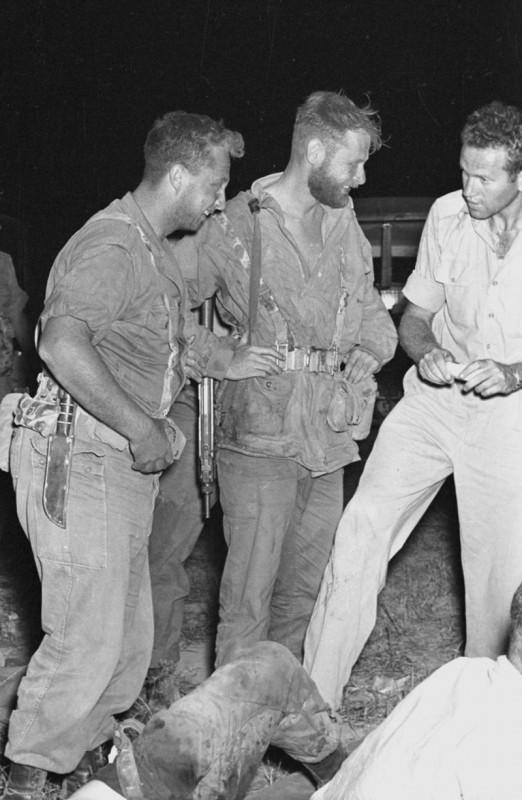 Aharon Davidi (center), one of the commanders who led the attack, with Ariel Sharon (left) Public domain