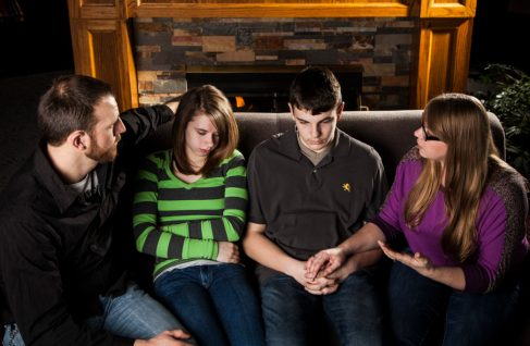 Teens grieve with family
