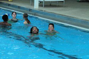 Children swimming during Pathways Breakaway event.