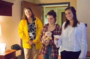 Oakwood High School students & Lasertoma group give stuffed teddy bears to patients at Ohio's Hospice of Dayton Hospice House.