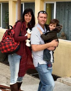 mom and dad leaving orphanage with young child