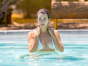 Rachel McCord at a pool in Indio having bikini malfunction exposing her nipple