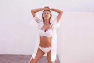 Kate Upton looks sexy wearing white lingerie