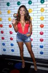 Arianny Celeste looks hot wearing denim shorts and revealing red top exposing her big boobs