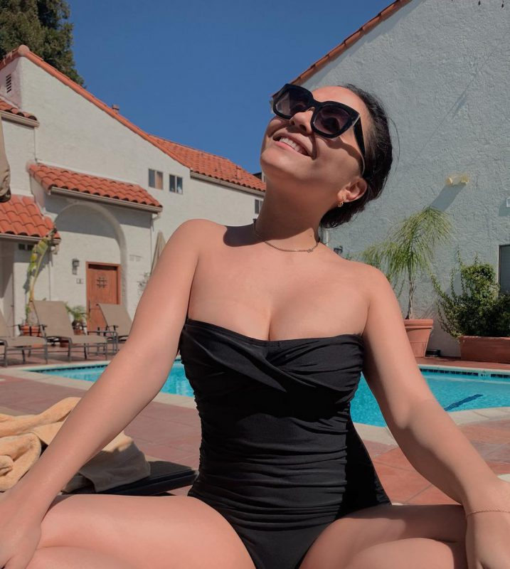 Stella Hudgens In A Black Swimsuit