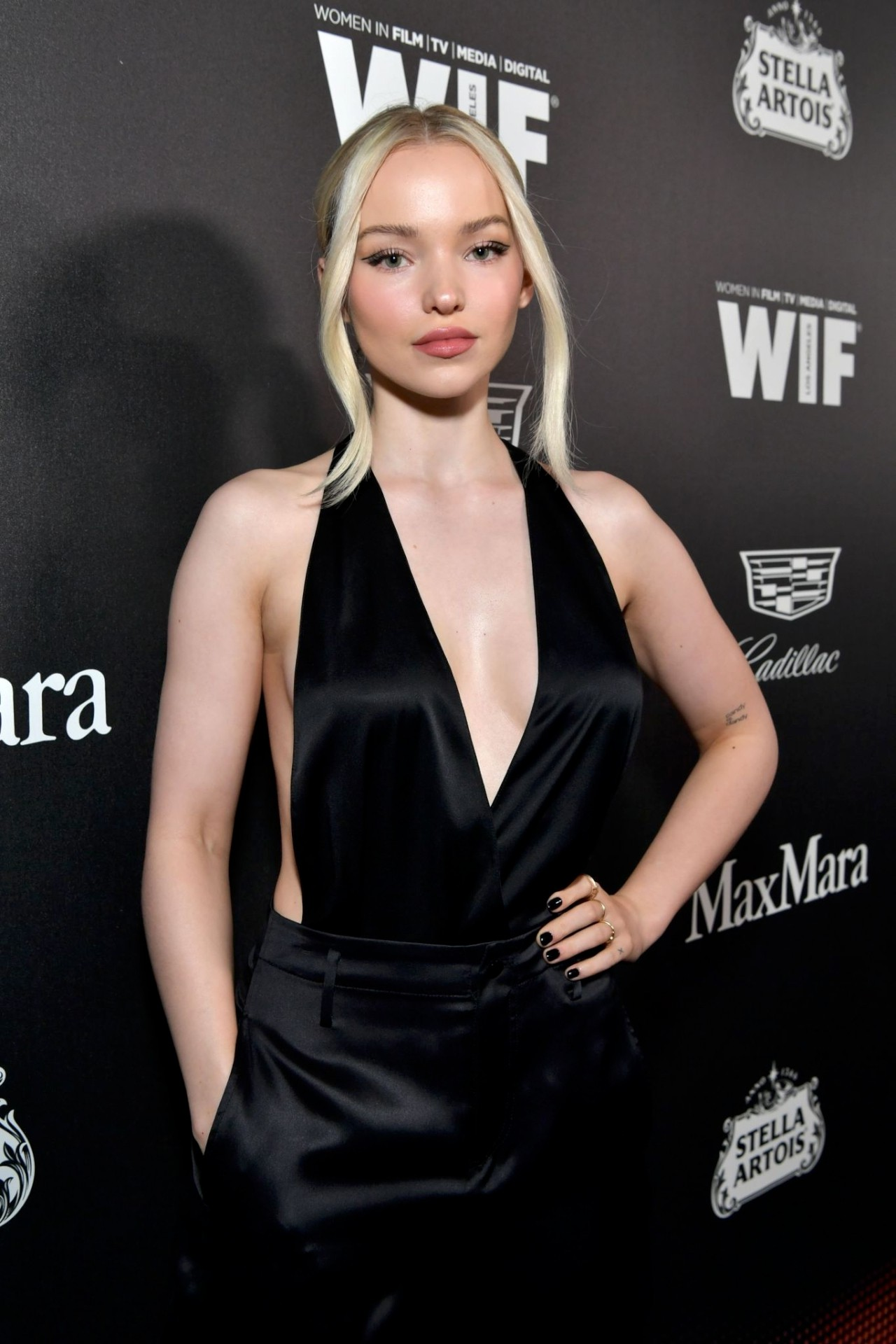 Dove Cameron Braless Cleavage In Black Low Cut Dress