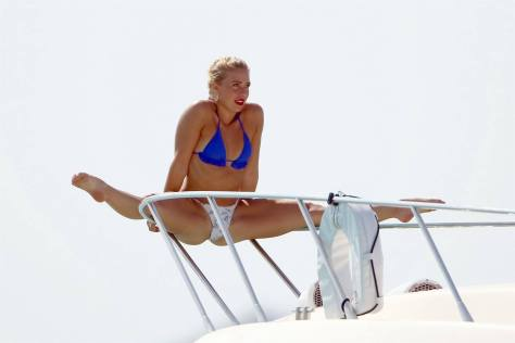 Gabby Allen show off her fit body wearing small bikini as she enjoys a day by the sea with friends in Ibiza.