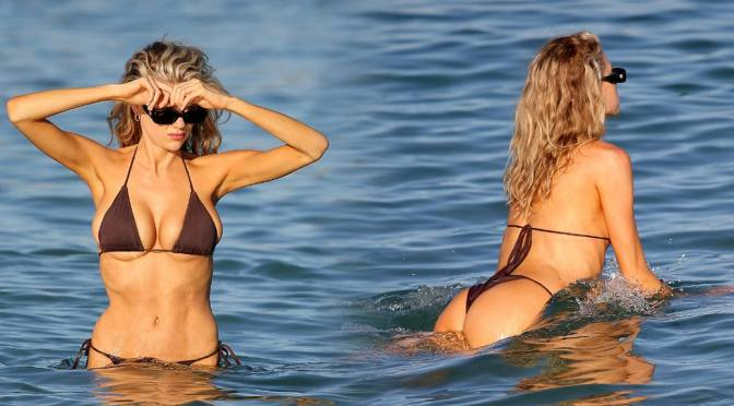 Charlotte Mckinney – Big Boobs in a Tiny Black Bikini on the Beach in Miami