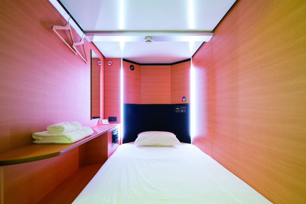 A bank of sleep capsules, and a sleep capsule interior