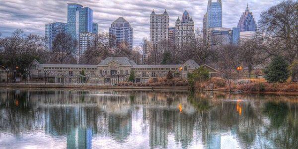 The Atlanta skyline with Lake Clara's reflection in Piedmont Park