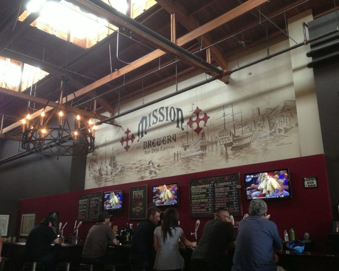 Wide open taproom inside Mission Brewery in San Diego, California, a perfect spot to grab a daytime brew.