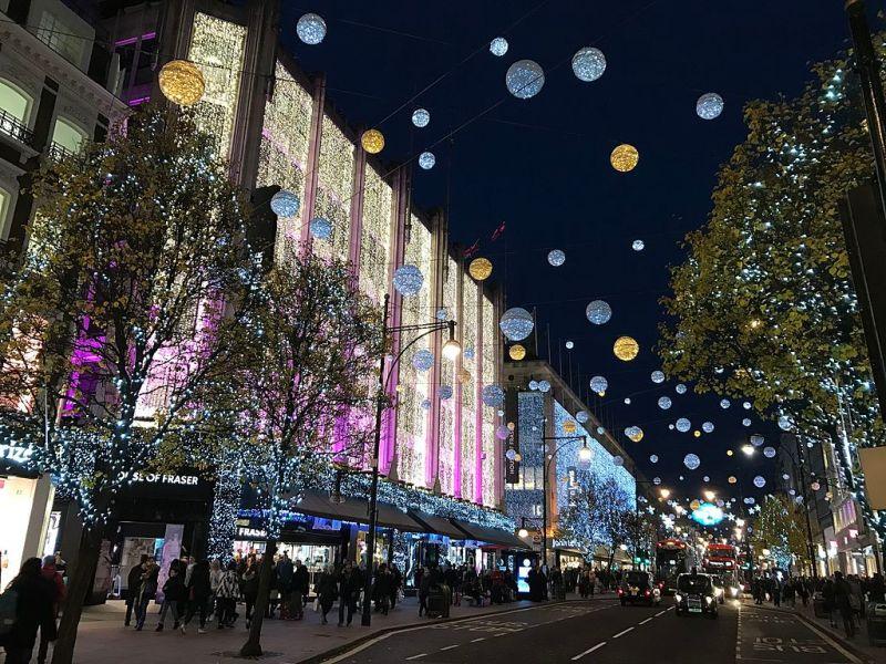 Magical Christmas and holiday lights shine on London street