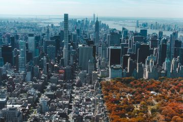 Aerial skyline view of Manhattan with the vibrant colors of Central Park.