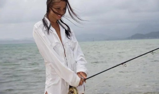 Girl fly fishing in just a white shirt